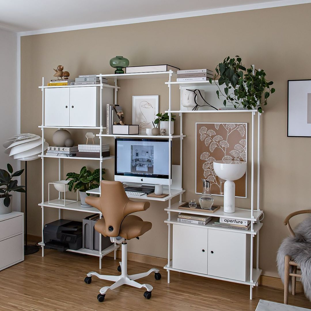 brown hag capisco chair in leather in home office