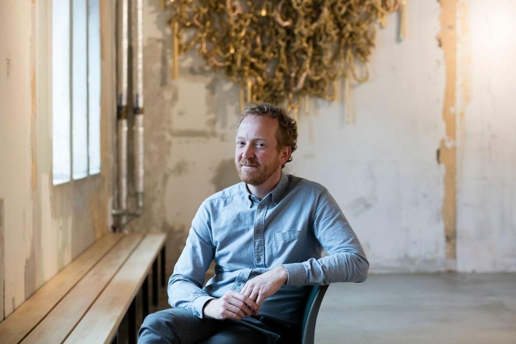 Flokk SVP Christian Lodgaard sitting on a chair