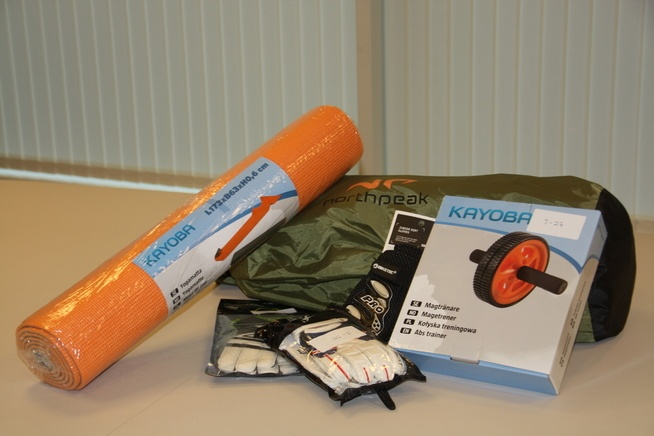 Examples of toxic material products including an orange camping mat goalkeeper gloves a green satchel and an orange wheeled toy
