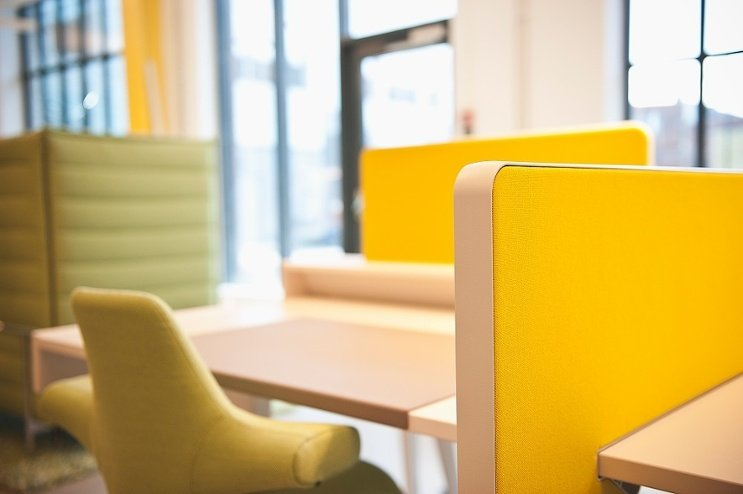 bright yello hag capisco chair within a yellow workstation at media evolution city, Malmö, Sweden