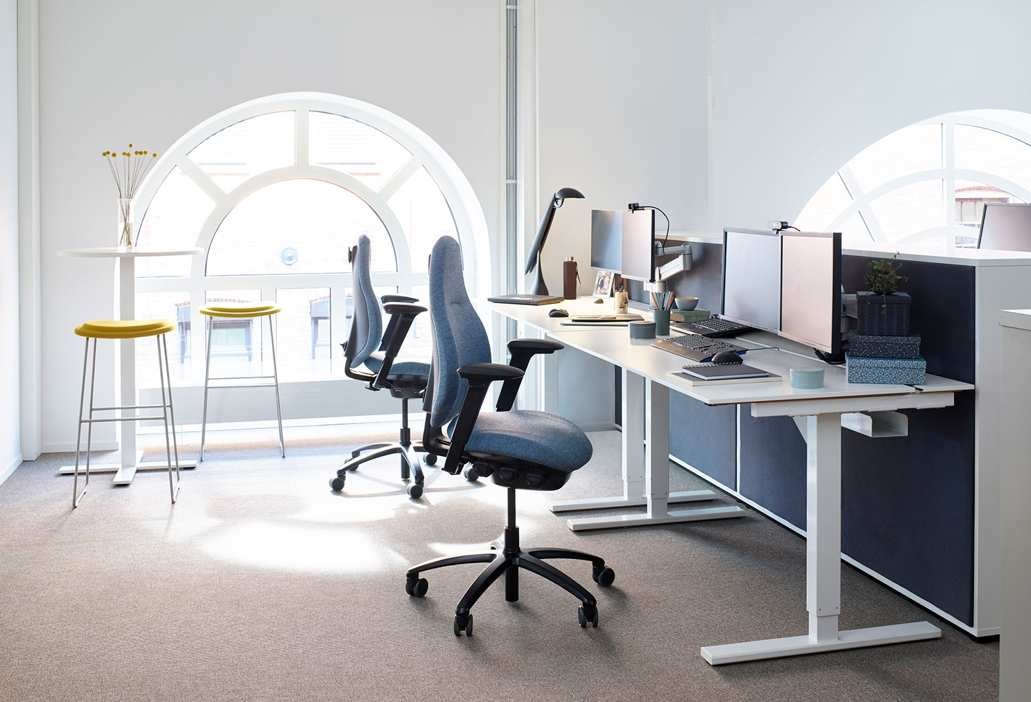 RH mereo chairs at office desk