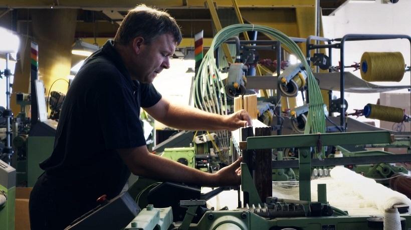 factory worker at roros tweed