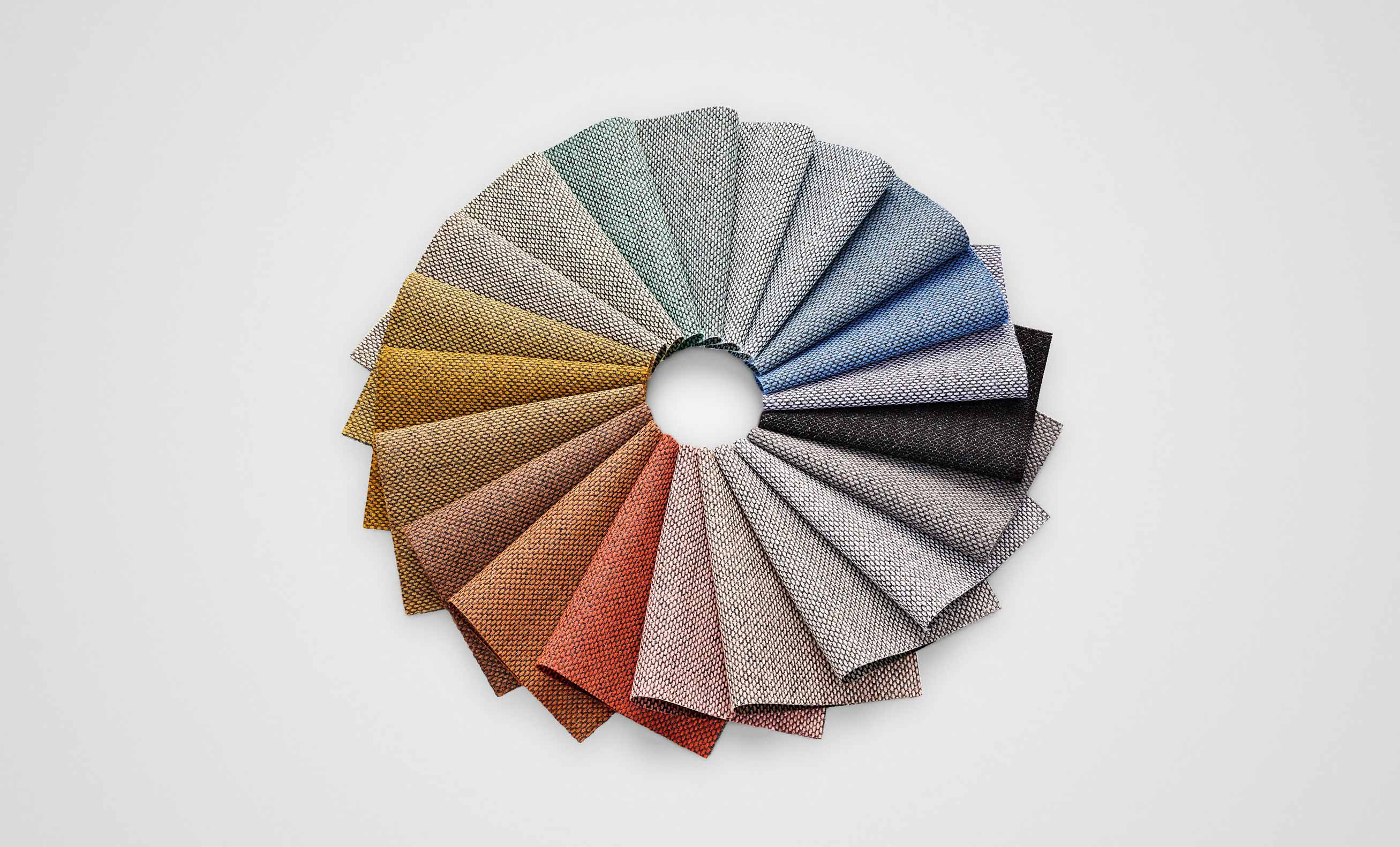 selection of re-wool fabric colour samples laid out in a wheel shape