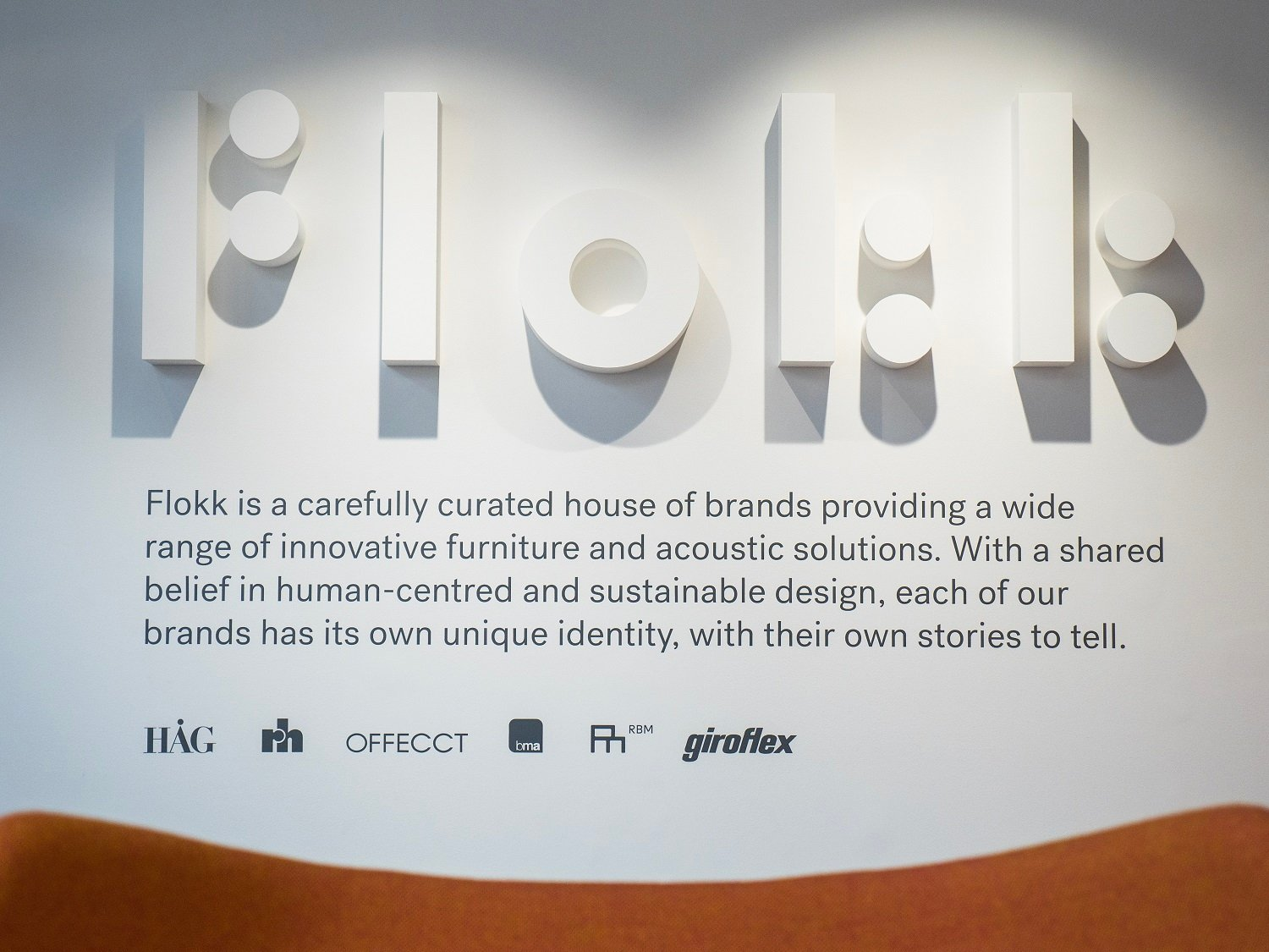 UK Flokk showroom with Flokk mission statement on wall