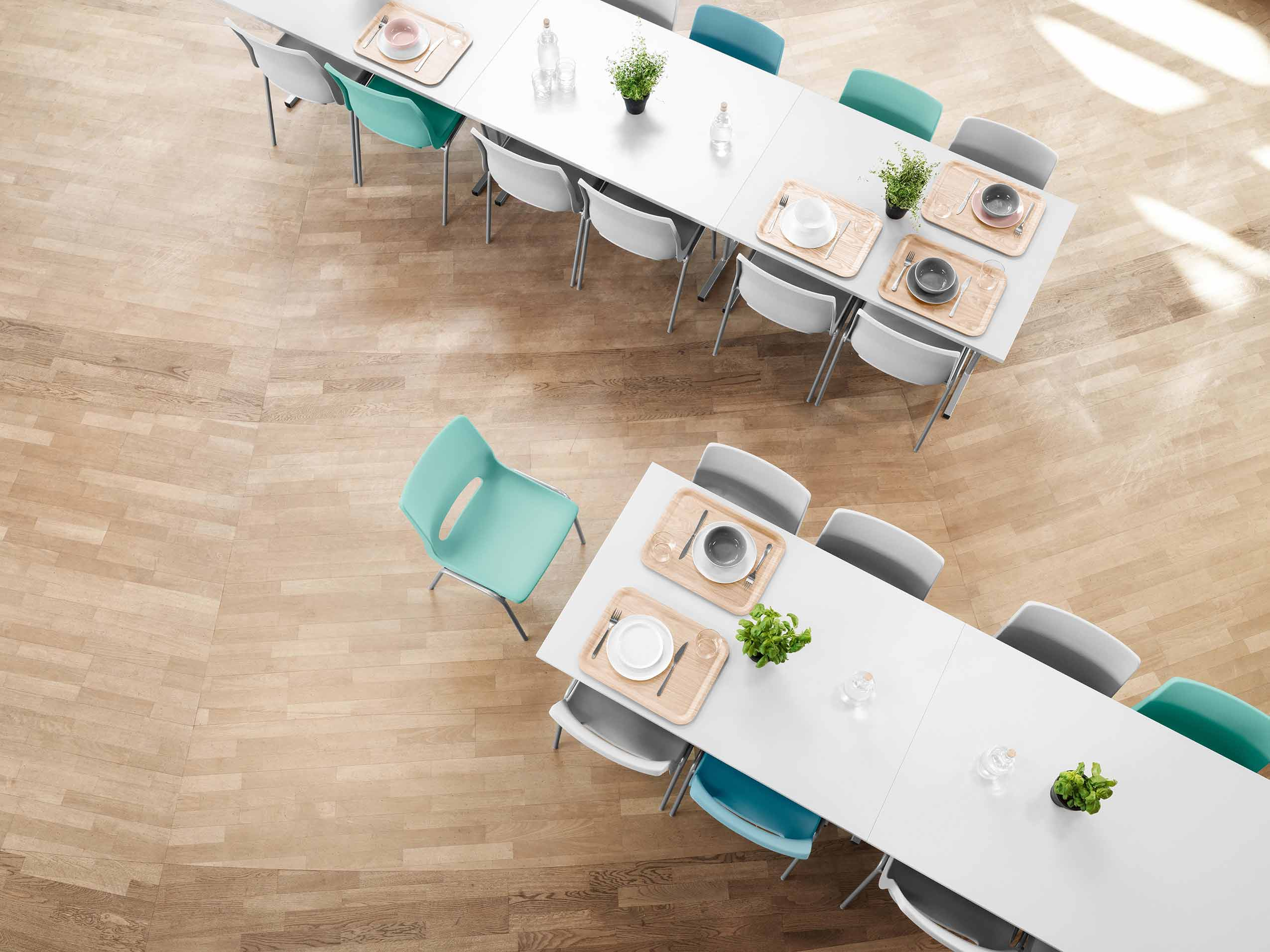 sea green and white RBM Ana Chairs in a canteen