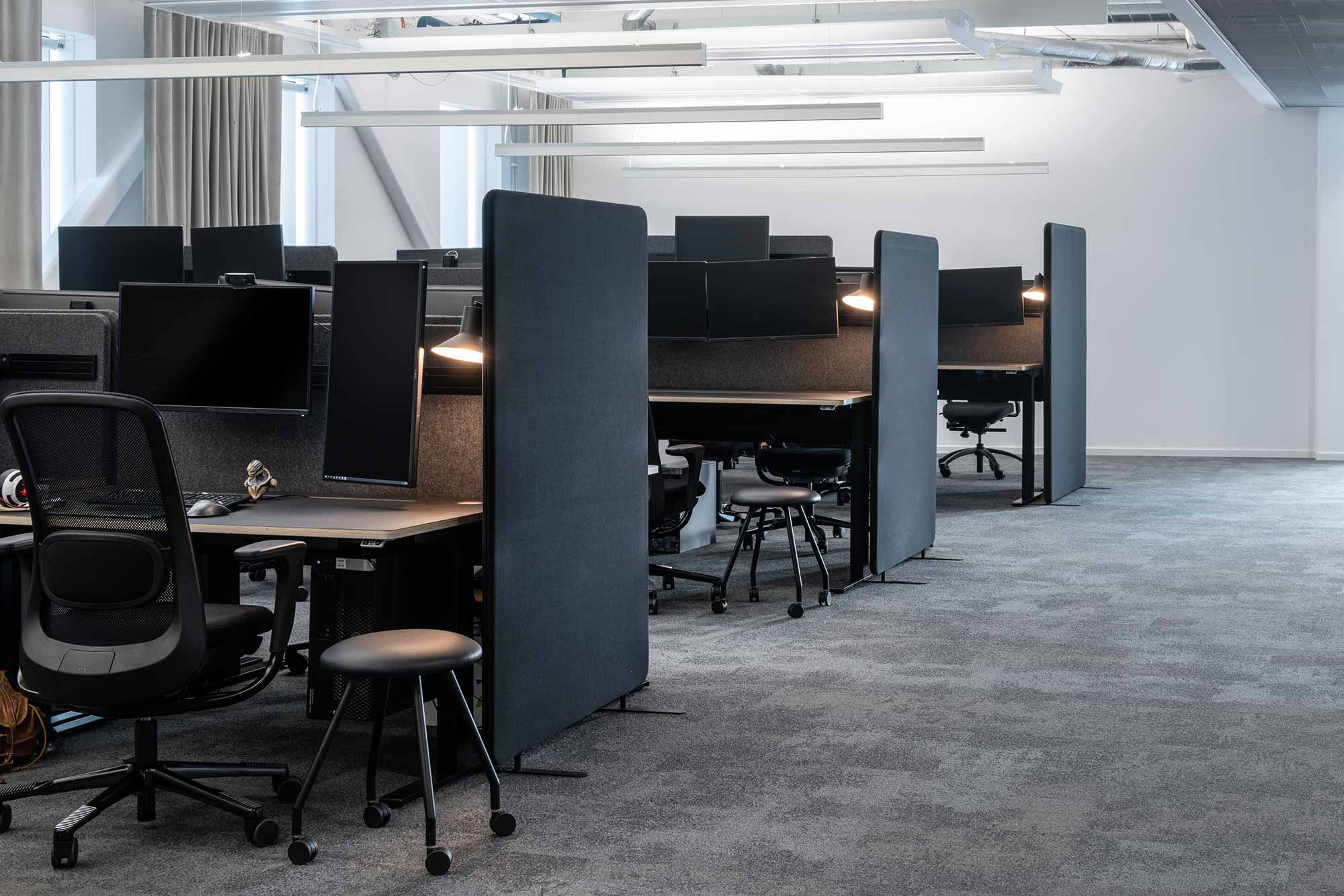 office cubicles at goodbye kansas with black HÅG Sofi mesh chairs