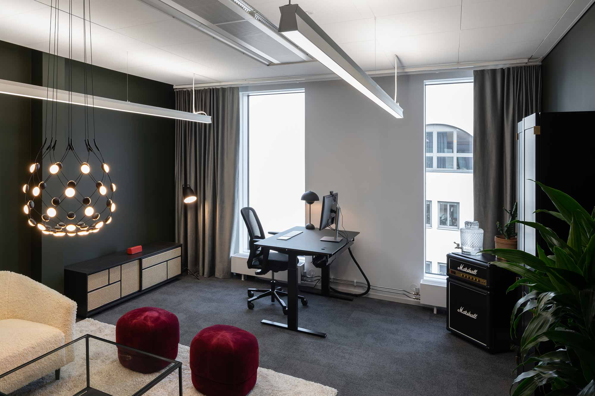 private office featuring HÅG SoFi chair with blalck walls and marshall guitar amp