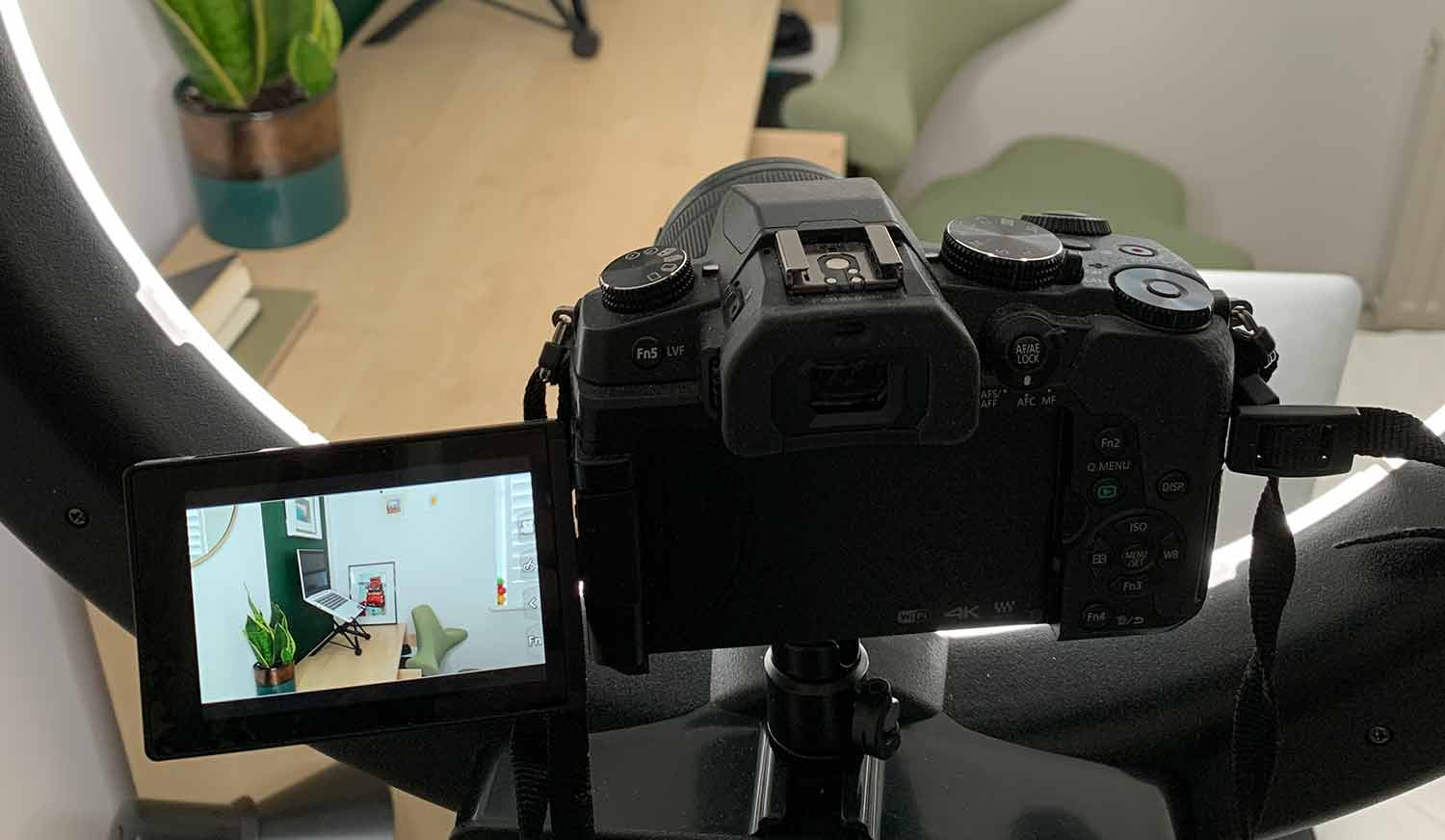 close up of camera filming a home office setup