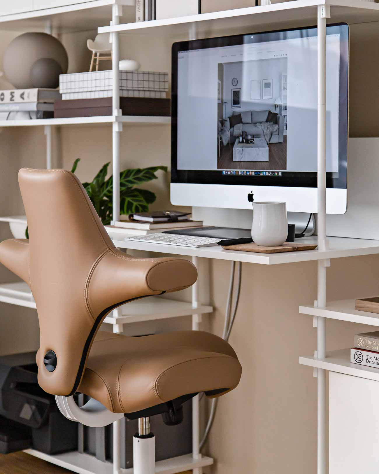HÅG Capisco in brown leather at home office desk in living room