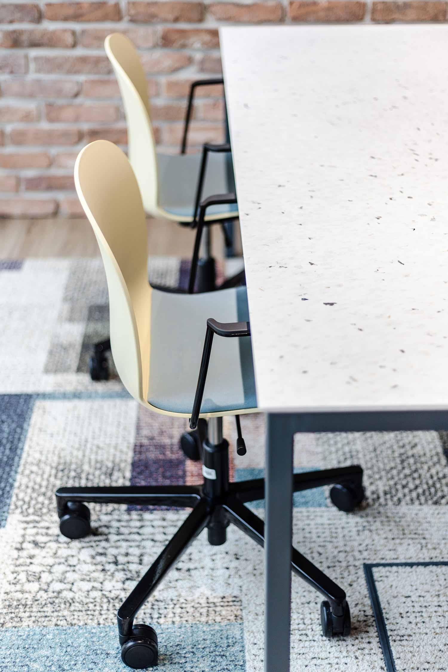 closeup of RBM Noor wheeled footbase chair