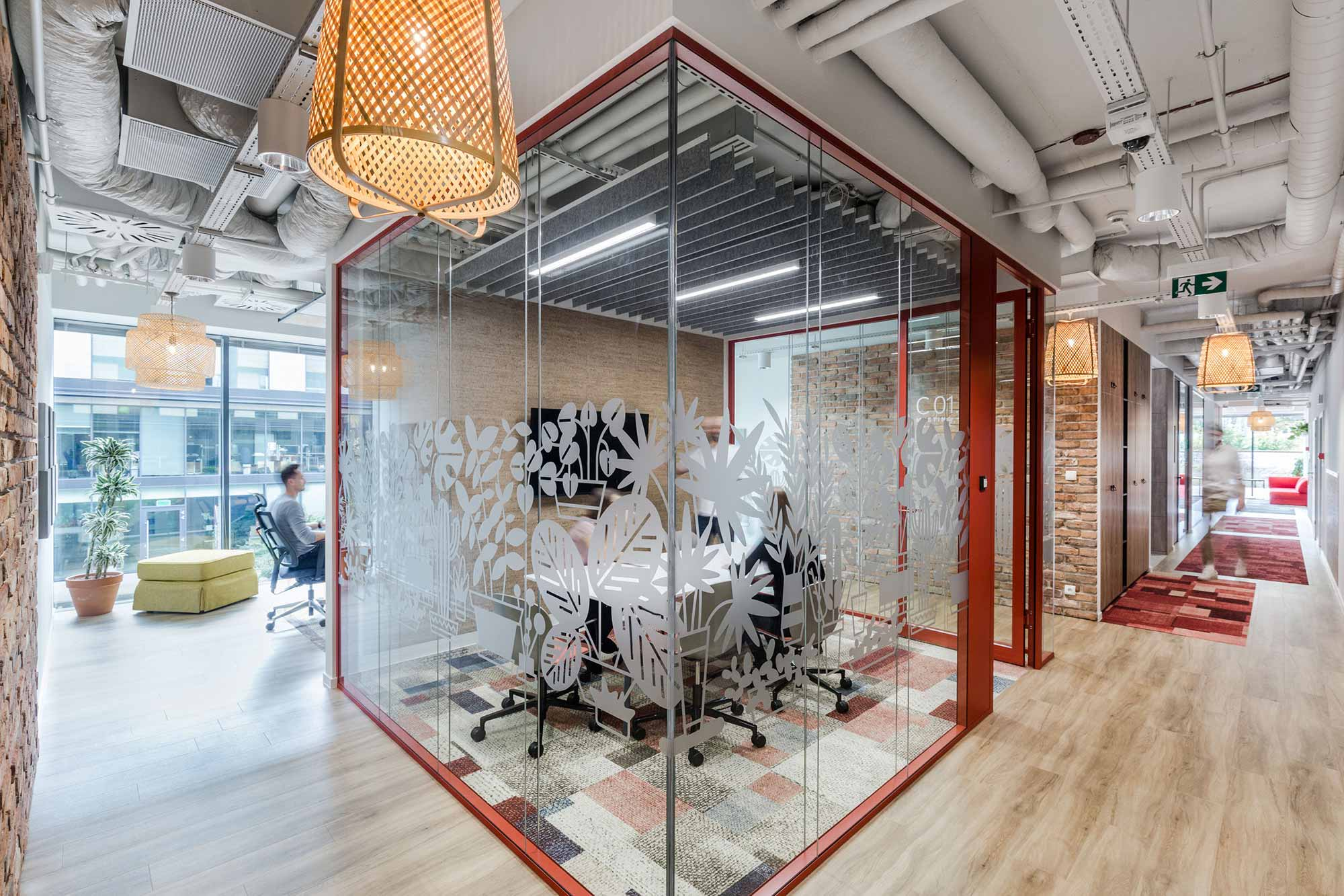 glass walled meeting room at Nordea Less Waste Office in Poland