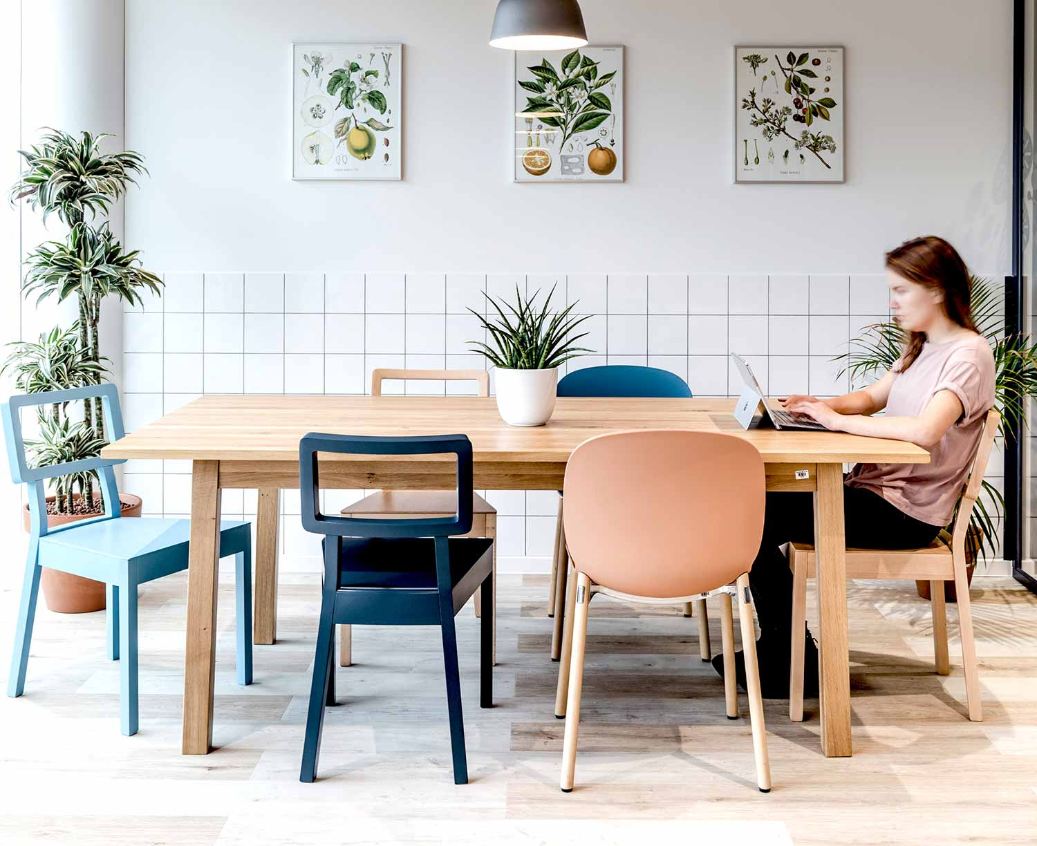Bright scandinavian style cafeteria space in office featuring Coral RBM Noor chair with wooden legs