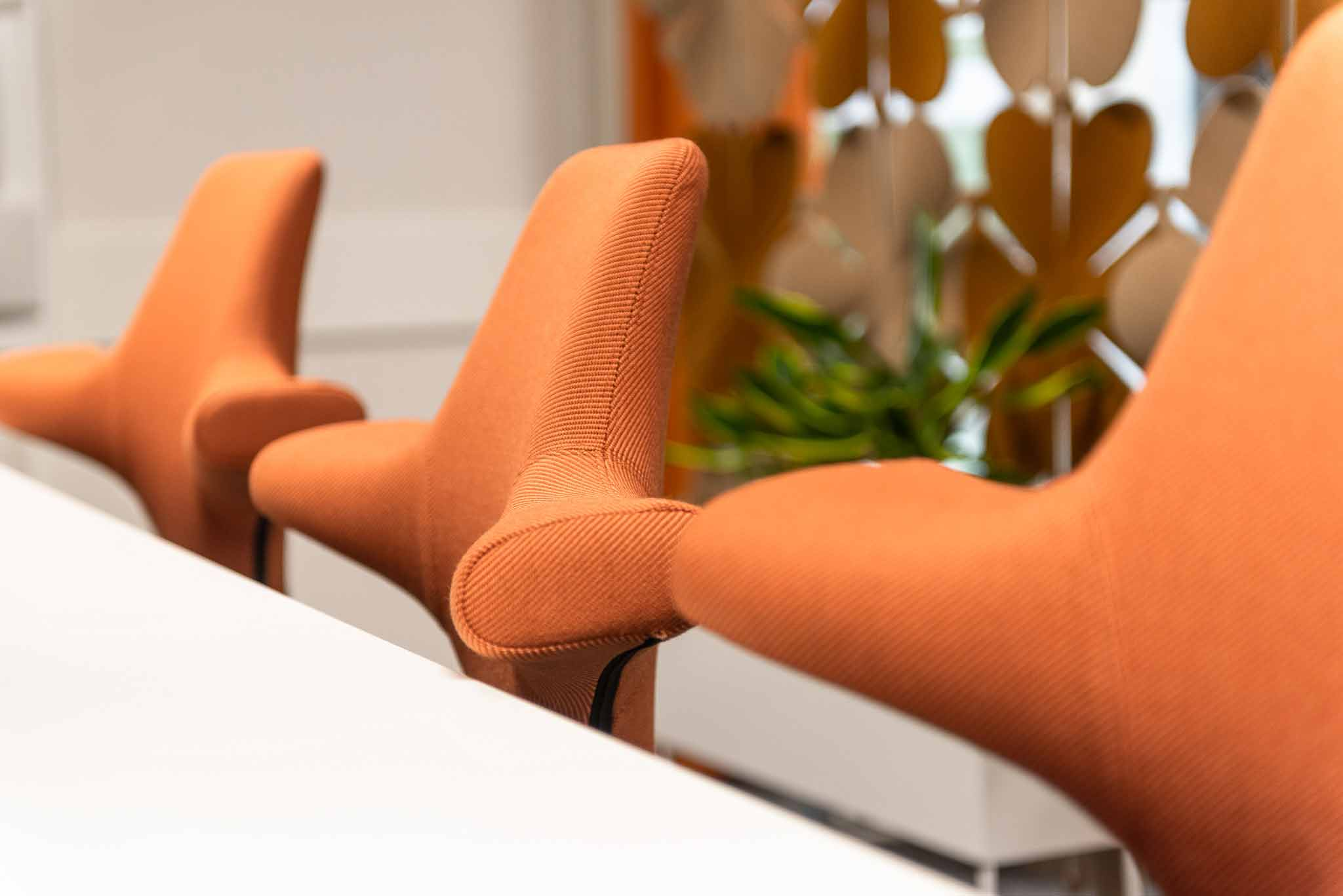 Clase up of Hag capisco chairs with orange fabric in skandia office in sundsvall