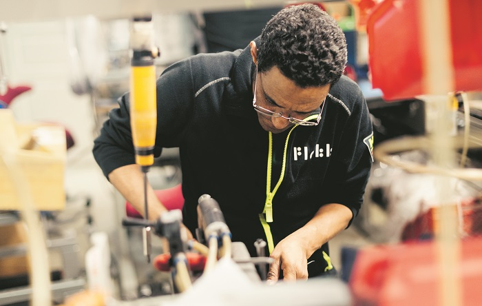 Flokk factory worker creating furniture