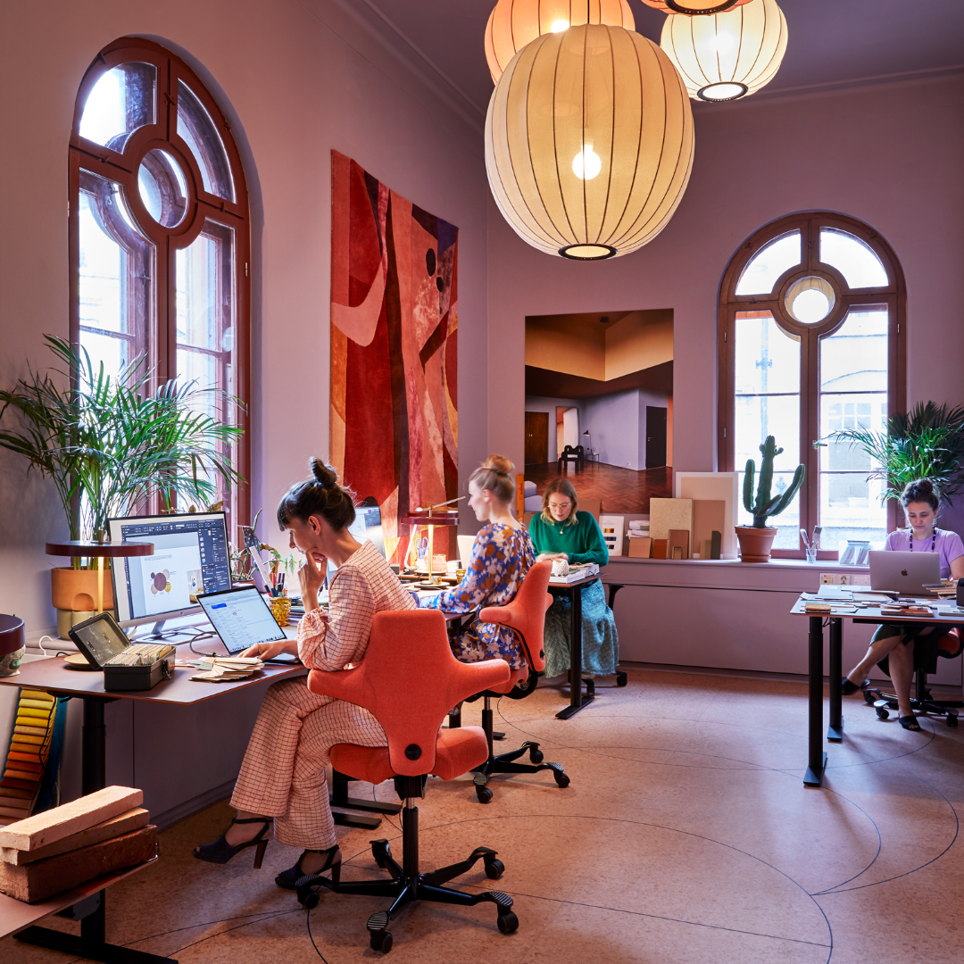 colourful workspace featuring HÅG Capisco chairs