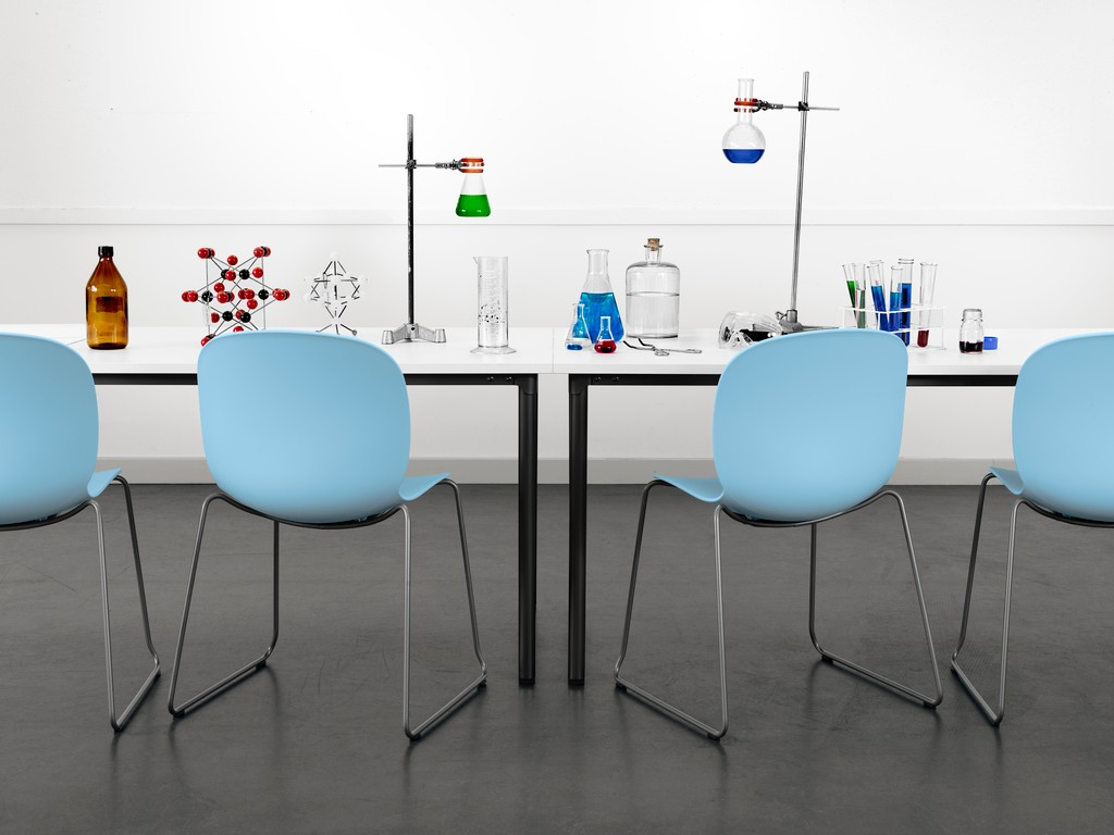 4 Sky blue RBM Noor chairs at a table with science experiments using glass tubes and colourful liquids