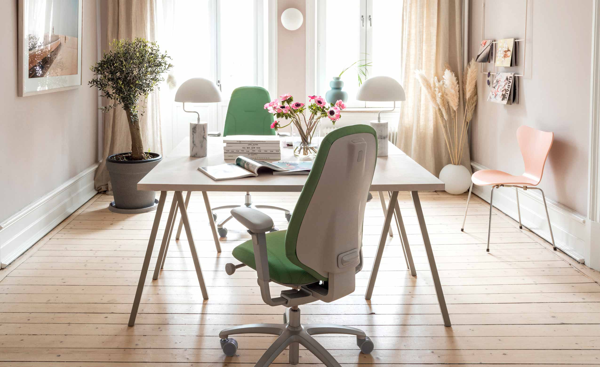 two green RH Mereo chairs in a light office