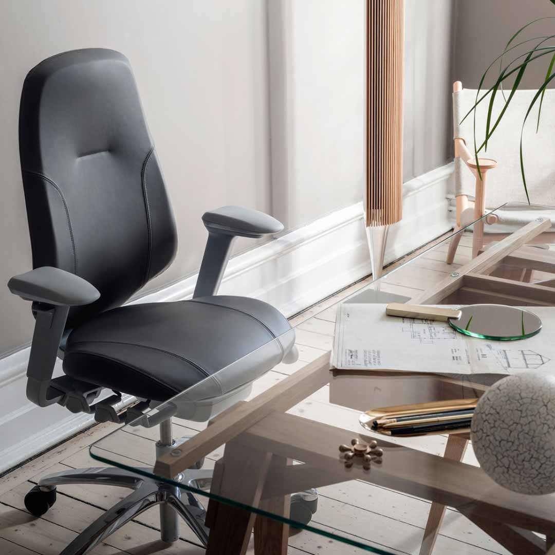 black leather RH Mereo chair at glass table