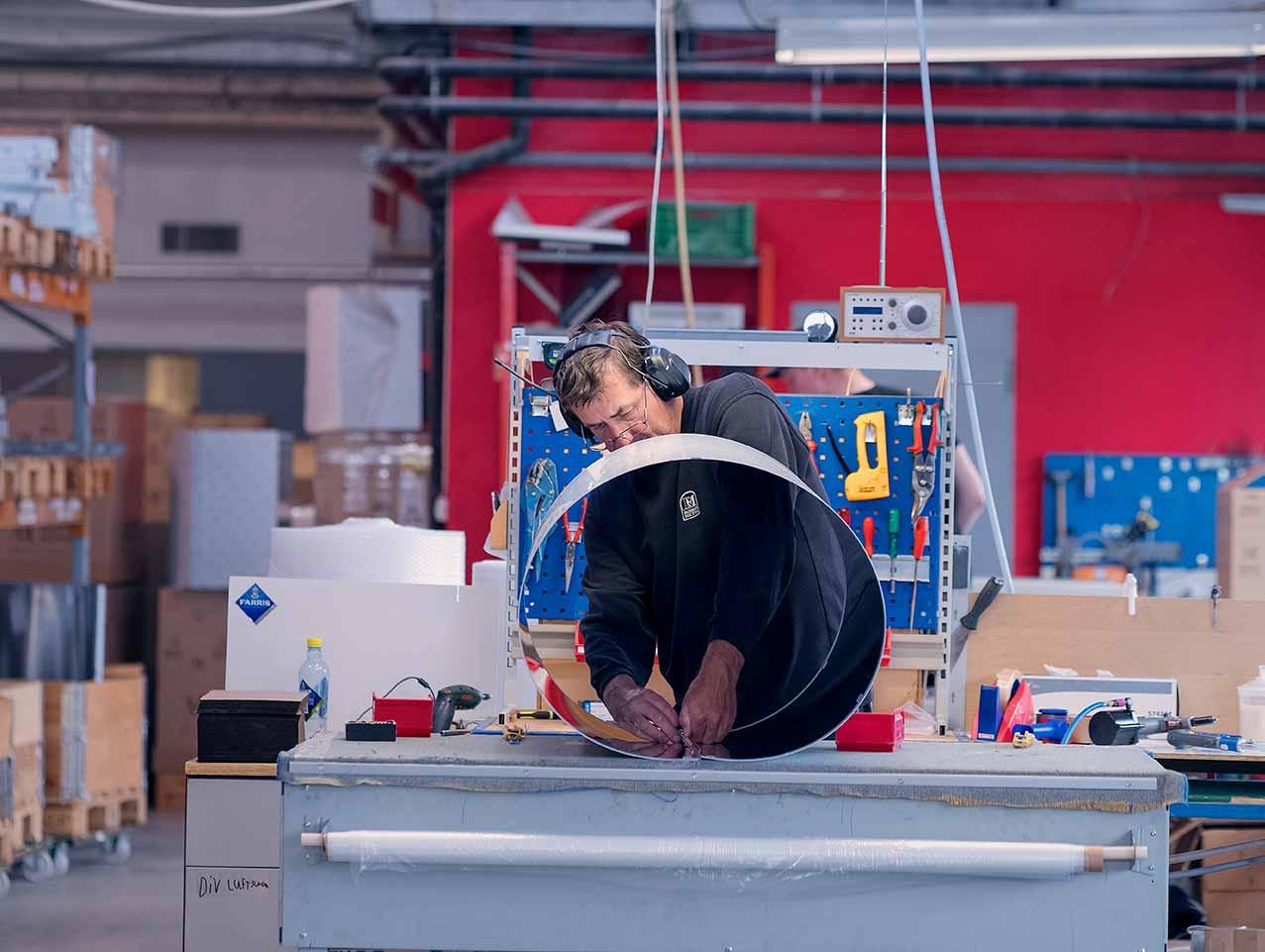 worker at roroshetta factory bending metal sheets